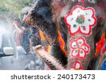 elephant splashing water during ... | Shutterstock . vector #240173473
