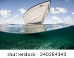 A Boat Floats In Shallow Water...