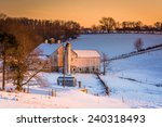 View Of A Barn On A Snow...