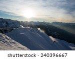 skiers on the piste at dusk ... | Shutterstock . vector #240396667