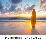 surfboard on the beach at sunset | Shutterstock . vector #240417523