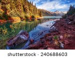 rocky lakeshore in the... | Shutterstock . vector #240688603