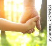 adult holding a child's hand ... | Shutterstock . vector #240704803