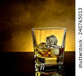 whiskey glass with ice and warm ... | Shutterstock . vector #240765013