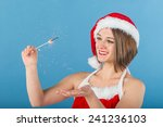 girl in red and white christmas ... | Shutterstock . vector #241236103