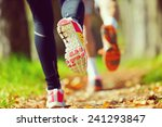 young couple jogging in park at ... | Shutterstock . vector #241293847