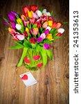 tulips in the vase on wooden... | Shutterstock . vector #241353613