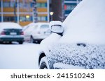 Consumer Car Covered By Snow I...