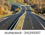 empty highway leading across... | Shutterstock . vector #241545337