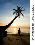 silhouette life at sunset beach. | Shutterstock . vector #241933237