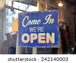 blue open sign hanging at the... | Shutterstock . vector #242140003