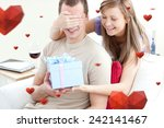 smiling woman giving a present... | Shutterstock . vector #242141467