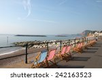 Deckchairs On Seafront At...