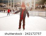 Small photo of Happy boy with red hat, skating during the day, having fun