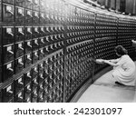 Small photo of Woman using the card catalog at the Main Reading Room of the Library of Congress, ca. 1940.