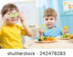 kids eating healthy food in... | Shutterstock . vector #242478283