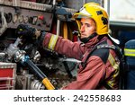 Fireman Controlling Water...