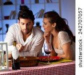 romantic couple having dinner... | Shutterstock . vector #242707057