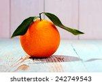 One Big Ripe Orange Fruit With...