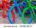 three colorful bicycle wheels... | Shutterstock . vector #242813017