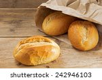 bread rolls in a paper bag on a ... | Shutterstock . vector #242946103