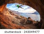 male rock climber climbing... | Shutterstock . vector #243049477