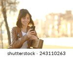 happy girl using a smart phone... | Shutterstock . vector #243110263