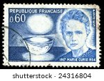 Vintage french stamp depicting Marie Curie who won two Nobel prizes in Physics and Chemistry for her work on Radioactivity and the discovery of radioactive chemical elements - stock photo