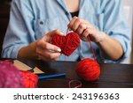 woman creating red woolen heart   Shutterstock . vector #243196363