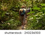 tourists in the jungle | Shutterstock . vector #243236503