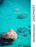 crystal clear blue sea with two ...   Shutterstock . vector #243294097