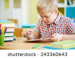 clever learner using touchpad... | Shutterstock . vector #243360643