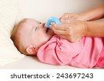 baby with nasal vacuum aspirator | Shutterstock . vector #243697243