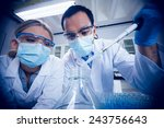 science students using pipette... | Shutterstock . vector #243756643
