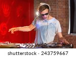 cool dj spinning the decks at... | Shutterstock . vector #243759667