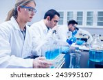 science student using pipette... | Shutterstock . vector #243995107