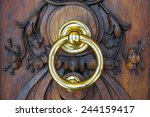 brass knocker in a wooden door