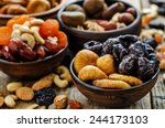 mix of dried fruits and nuts on ... | Shutterstock . vector #244173103