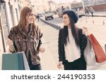 happy women walking in the city ... | Shutterstock . vector #244190353