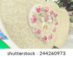 heart box with white ribbon and ... | Shutterstock . vector #244260973