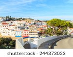 a view of carvoeiro city in... | Shutterstock . vector #244373023