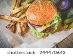 delicious burger and chips ... | Shutterstock . vector #244470643