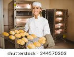 baker smiling at camera holding ... | Shutterstock . vector #244570303