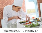 Small photo of Smiling cook preparing appetizer