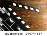 movie clapper on wooden... | Shutterstock . vector #244744657