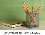 Pencils In Metal Holder Near...