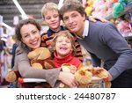 family of four in shop with toys | Shutterstock . vector #24480787