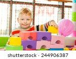 little boy play construction set | Shutterstock . vector #244906387