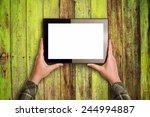 hands holding digital tablet... | Shutterstock . vector #244994887