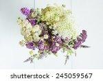 Постер, плакат: a vase of wildflowers